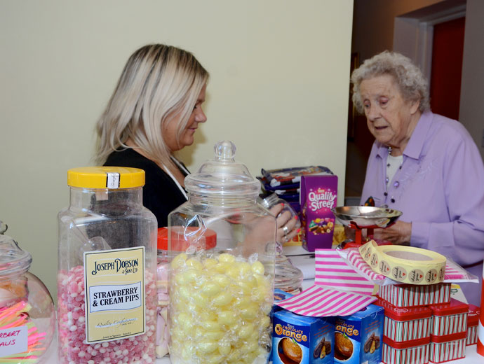 Carer and sweet shop
